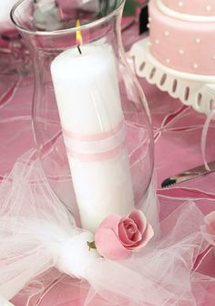 Blush pink table decor - white candle in a clear vase with tulle and rose accents #blushpink #blushpinkwedding #weddingdecor #centerpiece #diywedding