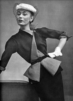 1951 Model in navy wool suit, belted with reverse flare by Jean Dessés, photo by Philippe Pottier