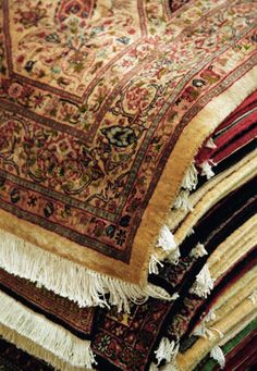 There's just something special about a stack of Persian rugs
