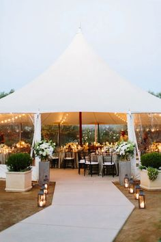 minimalist tent wedding with wooden accents - What if you line the walk with candles? real or LED or lanterns if we found modern ones