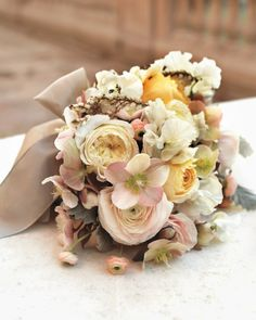 Petite posies can be just as impressive as larger-than-life bouquets. It's all about mixing lots of color (like the cream, beige, and pink tones here) with lots of texture (sweet peas, roses, hellebores, and dusty miller) for a can't-take-your-eyes-off-it effect.