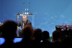 BOXED IN: Nokia Chief Executive Stephen Elop arranged his notes at Nokia's annual shareholder meeting in Helsinki, Finland, Tuesday. He said Nokia will fight to gain U.S. market share and will stick with its strategy of using Microsoft's Windows software for its Lumia smartphone lineup. (Markku Ulander/Lehtikuva/Reuters)