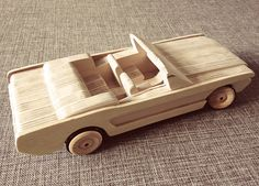 Wooden toy cars. Toy design. Mustang. Wood. Sculpture.