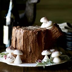 Chocolate-Malt Stump de Noël | Matt Lewis and Renato Poliafito worked together to create this stupendous holiday dessert, a twist on the classic, elegant French buche de Noel (so called because it looks like a log, or buche). To make their version, the Baked duo roll up frosted cake strips to form an enormous round, then set the dessert on its side to look like a huge tree stump.
