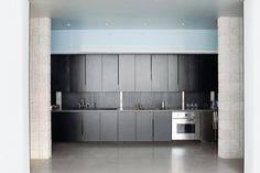 stained black plywood kitchen cabinets, atherton keener, Remodelista http://www.remodelista.com/posts/an-edgy-kitchen-with-custom-detailing