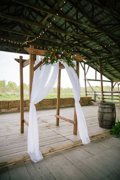 DIY Wooden Wedding Arch With Colorful Flowers | Burdoc Farms | Heather Todd Photography