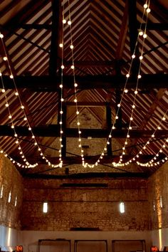 The festoon lights were strung between the barn's rustic rafters.
