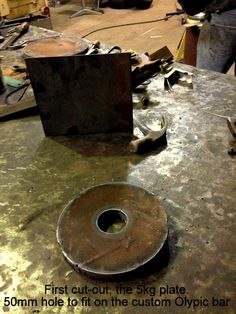 DIY 5kg weight plate. 50mm hole for olympic bar standard. First cut out. 20mm steel disk sourced and cut out from local scrap metal yard.