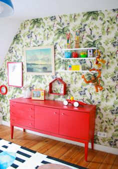 A 16th Century Home Begins A Playful New Chapter | Design*Sponge Jungle wallpaper found on eBay adorns one of the walls in Oskar and Otto's room. The red sideboard is one of Julia's numerous flea market finds.