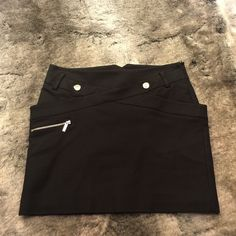 "Karen Millen black mini skirt Black mini skirt with silver zipper and button details. Invisible side zipper and pockets on hips. 15"" long. Karen Millen Karen Millen Skirts Mini"
