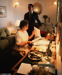 Work never stops: The Queen in her onboard study on the Royal Yacht Britannia dealing with official papers, 1991
