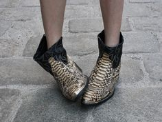 I would go to SLEEP with these snakeskin print booties on!!  Needless to say I LOVE them!  They would look amazing with anything from a white T and denim shorts or a classic LBD.