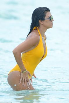Getting wet: At one point the small screen diva splashed water on her hips and thighs