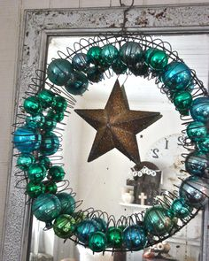 DIY holiday wreath.  Stretch out a slinky and fill with ornaments
