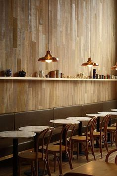Ninina Bakery | Buenos Aires. Vertical wood planks. Bronze industrial pendants. Thonet inspired chairs.