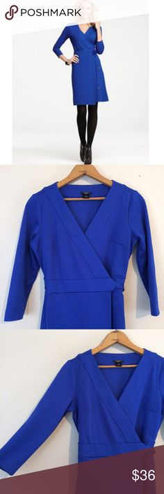 Ann Taylor Cobalt Blue Wrap Dress In like new condition, bright Cobalt blue wrap dress by Ann Taylor. Very flattering silhouette, perfect for the office! 3/4 sleeve, dress has some stretch. Ann Taylor Dresses
