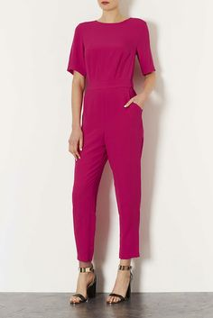 Turn heads in this hot pink jumpsuit http://www.iamintothis.com/2013/10/top-fashion-picks-on-this-weeks-high.html