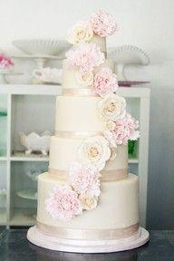 Peony and rose cake on ivory backdrop.
