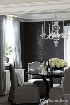 Textured black dining room walls & glass chandelier