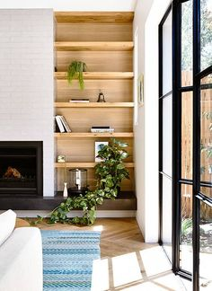 "Gorgeous Scandinavian Fireplace Design Ideas For Your Living Room - A stone fireplace plan your pioneer progenitors would envy is the ""Multifunctional Fireplace."" The hearth is developed high to make a capacity zone un."
