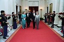 The Reagans and the Clintons walking a red carpet during the 1987 Dinner Honoring the Nation's Governors