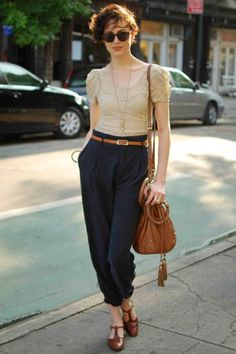 Elle's Street Chic: NY :: Who: Lisa Mettier What: Offset the romance of a lace top with menswear-inspired pants. Wear: vintage top, belt and sunglasses, Zara pants, Ferragamo shows, Topshop bag. | #fashion #outfits