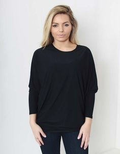 This black batwing top from Silvian Heach has an oversized style with a boat neck and batwing sleeves. The stretch polyester top is machine washable on a cold wash only. Batwing Top, Batwing Sleeve, Off Duty, Sweatshirt, V Neck, Tees, Casual, Black, Women