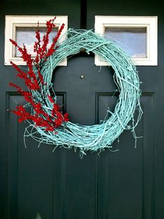 spray painted grapevine wreath with floral spray - @Juli Leonard Leonard Becker - we should make this soon!