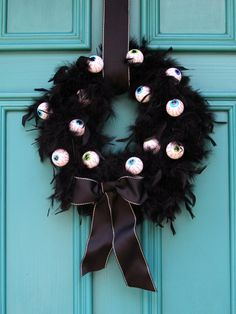 Add a little Cruella Deville style to your front door by wrapping a black feather boa around a wreath form then adorning it with some bloodshot eyeballs. Get the step-by-step instructions here.