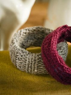 Just cover a plastic cuff in a strip of chunky knit (an old sweater works well), then hot-glue in place on the inside.