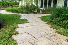 """The concrete pavers patterned with oolitic limestone texture age like the """"coral rock"""" of South Florida but are durable and can be power washed."""