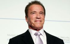 Arnold smiles as it is being announced that he will be the new host of Celebrity Apprentice