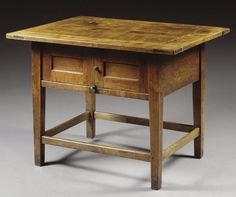 A TABLE WITH ENCLOSED CUPBOARD,  GEORGE III, LATE 18TH/EARLY 19TH CENTURY, POSSIBLY DEVON  ash, the segmented top above a pair of panelled doors