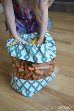 The toy bag tutorial by Peek-a-Boo Pages is great for beginners and comes with see through panels, so you don't have to label your bags. -Sewtorial