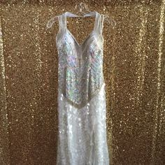 GREAT DEAL! Terani Couture white sequin gown Terani white and iridescent stoned and beaded prom or formal gown. Only been worn once to a prom and minimal sequins/beading missing. Would be a perfect prom, formal or occasion dress. This is an awesome deal! I just need to clear out pageant and prom dresses! Terani Couture Dresses Prom