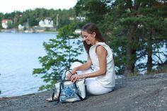 Louella Odié Reef Tote Bag, Levi's 710 Jeans, Amaya Arzuaga Maille Top, Zara Roman Sandals.jpg