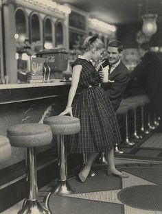 1950s couple in a date in a classic looking diner.