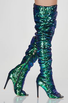 Thigh high sequin boots. Side zip closure with scrunched finish.
