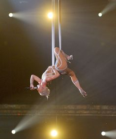 "Pink ~ At the Grammys in 2010, Pink performed the song ""Glitter in the Air"" while doing an aerial silks trapeze act. The rendition garnered her a standing ovation."