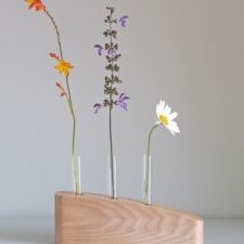 3 STEM FLOWER VASE IN ELM - A simple stylish flower stem vase hand crafted in Elm. This contemporary vase is a great way to have an exuberant display of flowers using only a few stems. I make each vase from an individual piece of wood, hand finished with natural oils to protect it and bring out the natural markings in the timber. A completely unique gift for a wedding, birthday or Christmas, or just a personal indulgence! £35.00 David Ames, Contemporary Vases, Flower Vases, Flowers, Natural Oils, Stems, Unique Gifts, Dining Table, Display