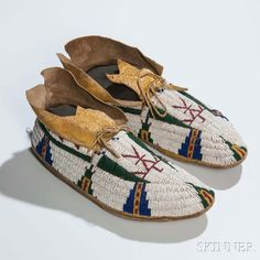 Cheyenne Beaded Hide Pictorial Moccasins, c. last quarter 19th century. | Lot 31 | Auction 2983B | Sold for $3,444