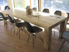 """The dining and conference table """"Rehwiese"""" is manufactured of 250 year old pinewood beams from a frame house in Dresden. The striking spots show the history of the timber."""