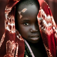 Africa | A Lendu girl at the health center of Aveba.  Ituti district, northeastern DR Congo | © Christophe Stramba-Badiali