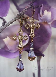 Victorian inspired and so detailed, these beauties feature filigree crosses in antiqued brass suspending orchid hued crystal beads and teardrops with ornate beadcap detailing.  Hung from leverback hooks in aged brass for pierced ears.    All components are American-made brass, free of lead and nickel   About 2.65