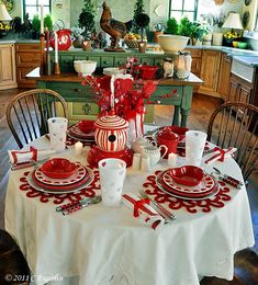 """White dinner plates - Rosenthal """"Medallion"""" Fiesta items are shown in Scarlet Ceramic bird house, cutwork plates, napkins, pitcher creamer/sugar - Home Goods Tumblers - Target Flatware is by Cambridge Placemats - Pier 1Votive coasters from marylandchina.com"""