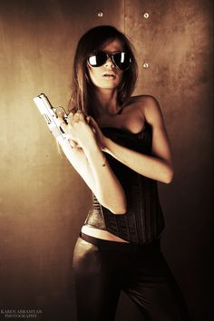 """Oh baby, you have no idea,"" he replied ruefully, brushing back my hair and tucking it behind  my ear. ""No idea at all. Now let me watch you shoot. Chicks with guns are hot."""