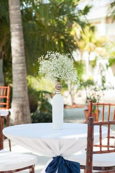 You could give some of the tables a little hight with this:) Babys breath in a white bottle