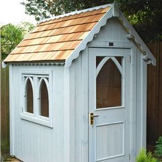Gothic shed from The Posh Shed Company. I could keep the lawn mower in here!