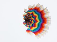 jen stark: rainbow artworks comprised of wood, paper and other organic materials meticulously cut into sculptures.