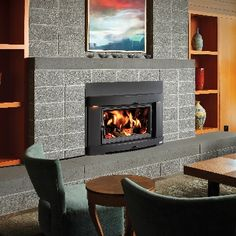 Avalon Large Flush Wood Hybrid-Fyre™ wood insert. Heats up to 2,500 sq. feet, with up to a 12-hour burn time. Available at Rich's.